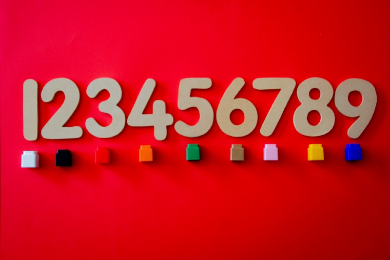 Red background with numbers and colored blocks